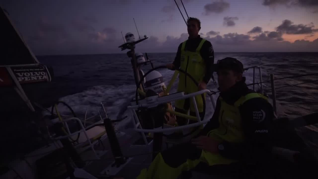 "At sunrise running in a good breeze through the Med. Bouwe: ""It's very nice sailing. We've got 15-18K of breeze, downwind, so that's always good. But you think back to yesterday, and we got a penalty in the first inshore lap. I think was not correct, because we MAPFRE was to weather of us. But we had to do a penalty turn... And then we had a huge wrap in our spinnaker, which was quite expensive... About a half an hour before we got it unwrapped."" Kyle on the helm."