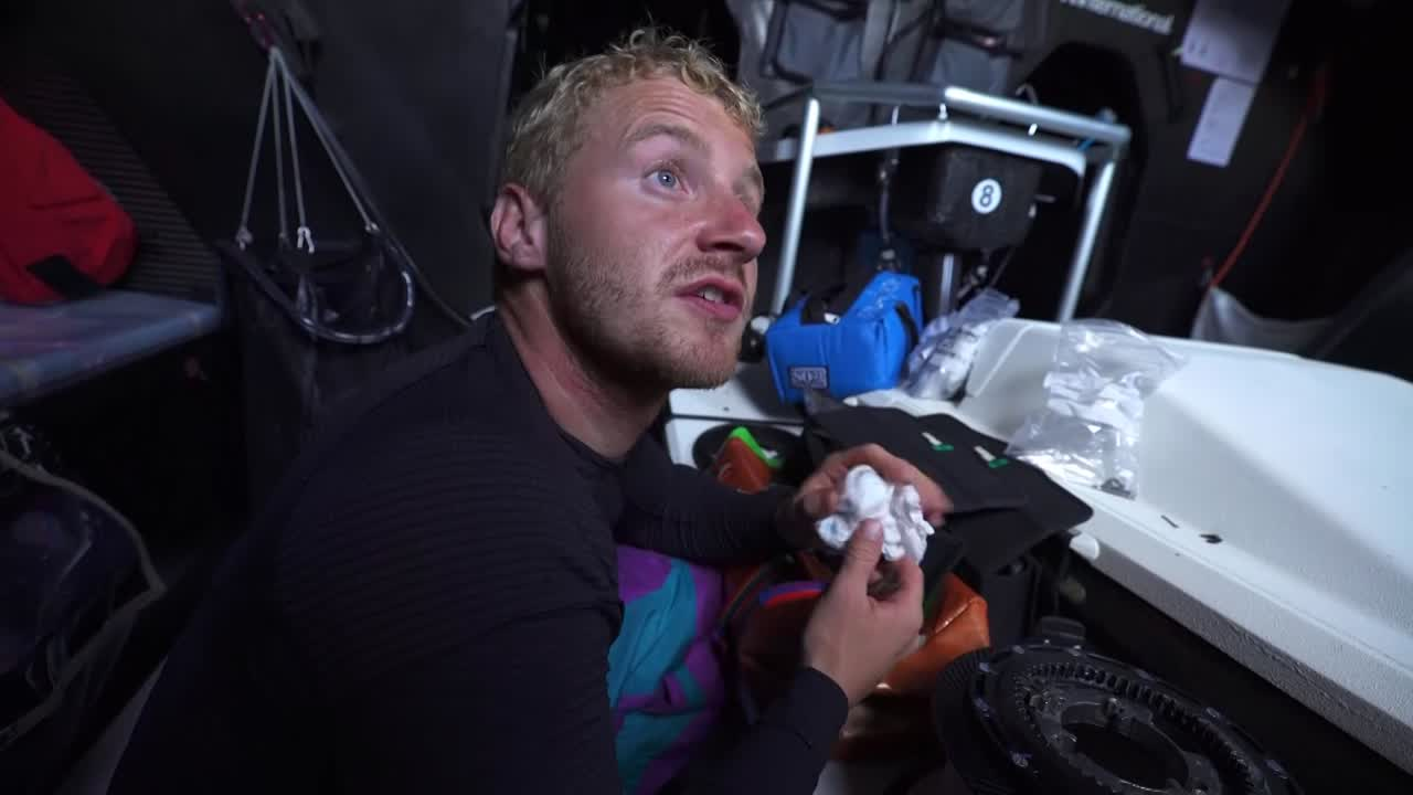 "Nicolai, below, works on a broken-down winch: ""We had a windy night last night, and when you have a bit of breeze it's always hard on the gear. We broke the winch we use to furl the sails, so just fixing that right now. Without the winches we can't pull the sails; we can't adjust anything... These are crucial. We need them all the time... So that's why I'm doing this now, and we'll have it back up in a hopefully couple of minutes, but probably half an hour."""