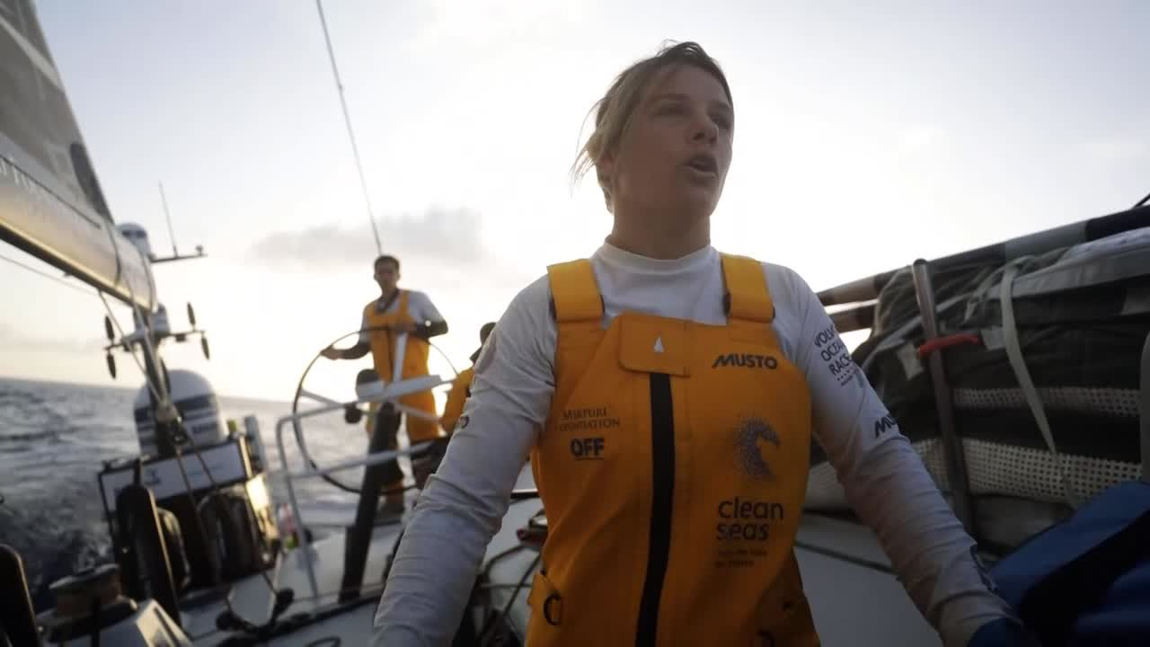 "Liz, at sunset, talks about the competition around them: ""We've got Brunel about 150 meters to weather of us, Scallywag about a mile and a half over there, and Dongfeng about a mile to leeward of us."" Shots of the other nearby boats."