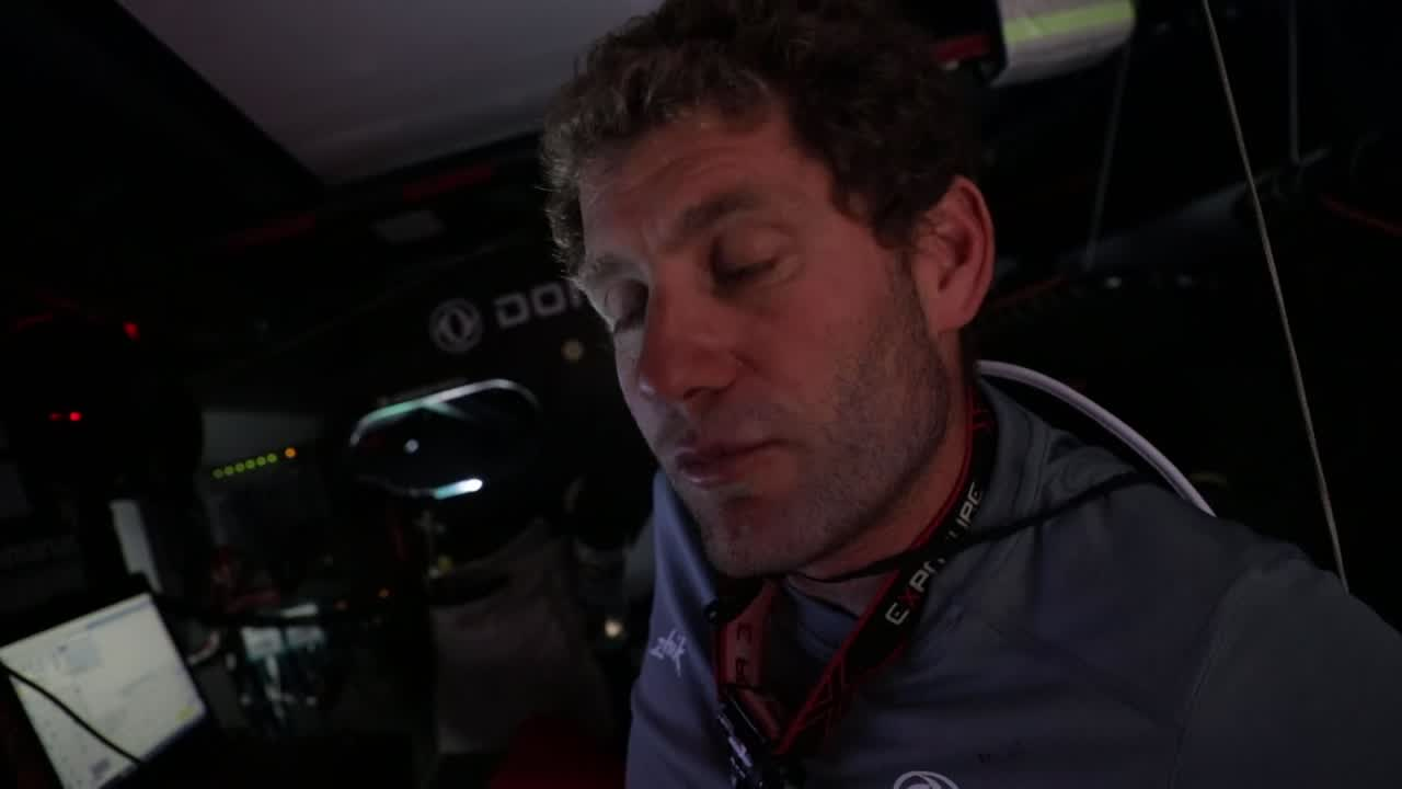Charles, at the nav station, talks in French (about their position relative to the other boats? No idea, really. Need a french-speaking obsessive to help out with translation).