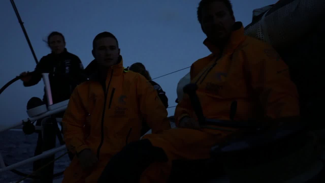 Shots of crew sailing just after sunset: Liz (I think) on the helm, Dee on the port rail.