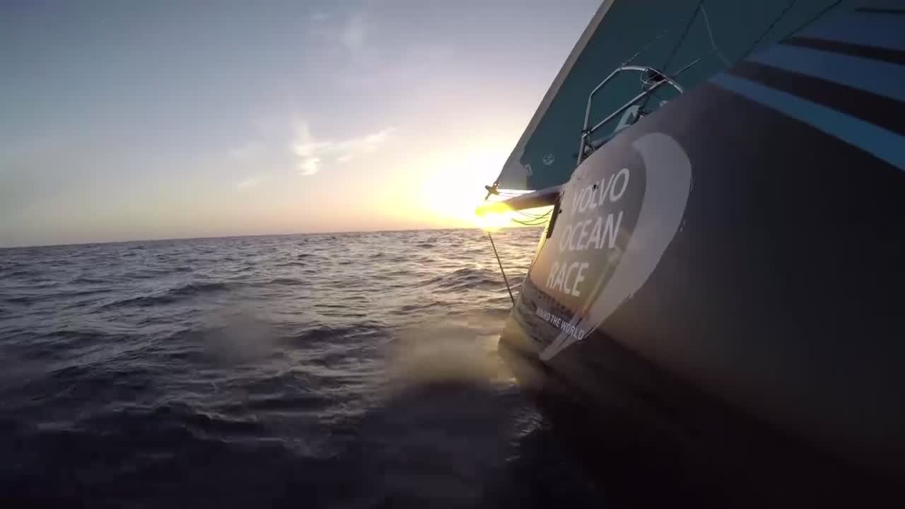 Shots of AkzoNobel sailing close-hauled toward the sunset in 7 knots of wind with the Masthead 0 and staysail.