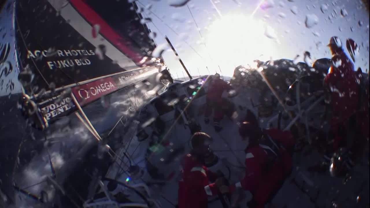 Crash cam footage of Scallywag surfing on starboard gybe toward the setting sun, then broaching to windward as the boat heels and the headsail flaps.They recover quickly.