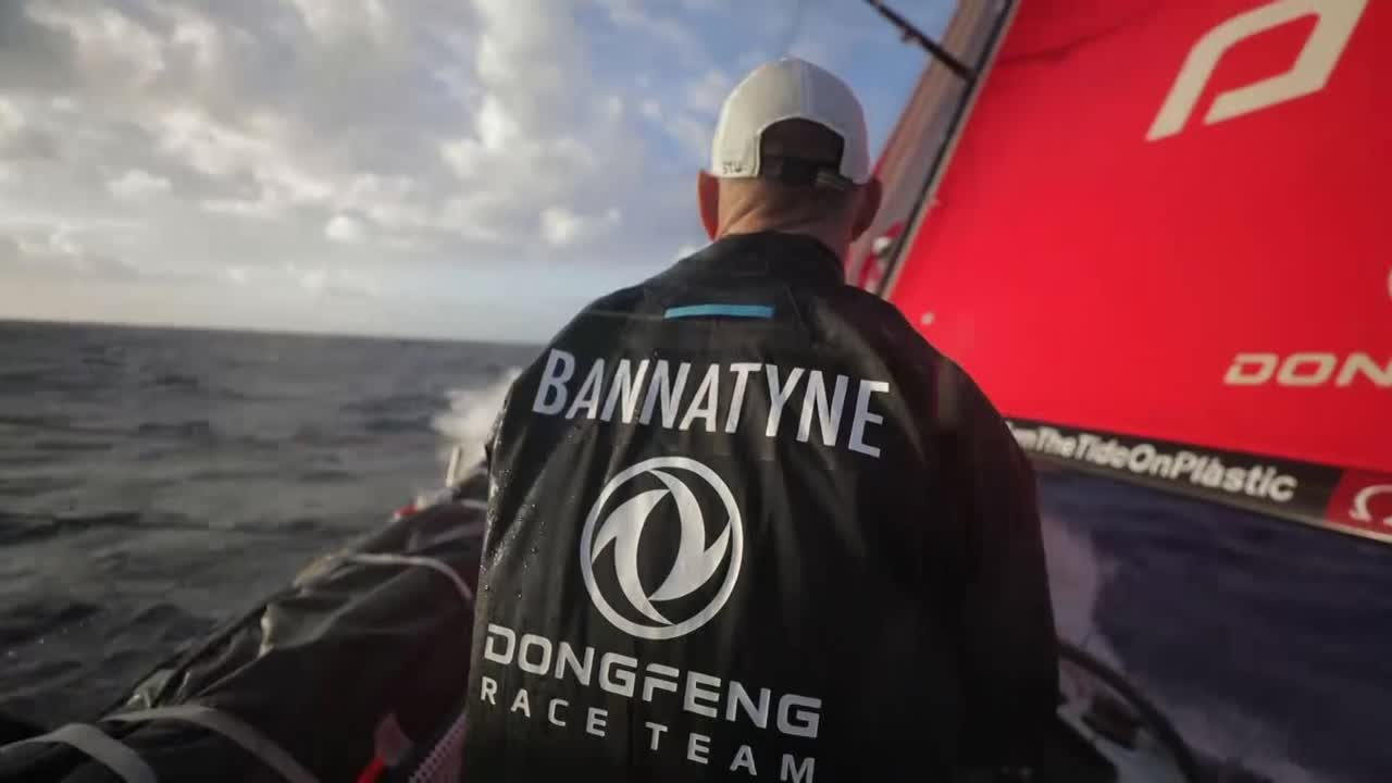 Stu, at the helm, driving Dongfeng on a fast port gybe. Sea state looks quite flat, but they are *flying*.