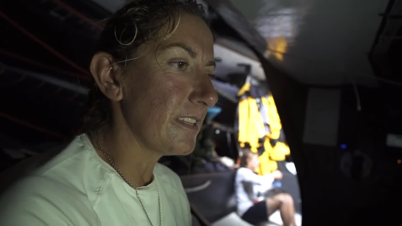 """At the nav station, Nicolas talks with Dee about the latest sched. Nicolas: """"It's not that drama."""" (?) Dee: """"Yeah, thank god."""" Nicolas: """"It is possible to think that they were 150 miles ahead."""" Dee: """"Easily."""" Dee talks to Sam: """"So where we thought life was ending for us, all is not lost. We're the furthest west, which is where Nico wanted to be."""" On deck in the evening, standing in the pit, Liz says: """"I'm gonna go and have a celebratory dump because we just had a great sched."""" Lucas: """"You made that word up. Celebrate-y isn't even a word, is it?"""" Liz: """"Celebratory? Yes, celebratory is totally a word."""" Lucas: """"It's not a word."""" Liz: """"It is. It is a word. I just said it, so it must be a word. It came out of my mouth, so it is a word. Celebratory, celebratory, celebratory..."""" On the stern, Liz squats down and acts like she's about to pull down her shorts, then straighens up and laughs. Liz: """"Get out of it."""" Two crewmembers (I think maybe Annalise on the helm and Bianca sitting forward of the helm?) laugh."""