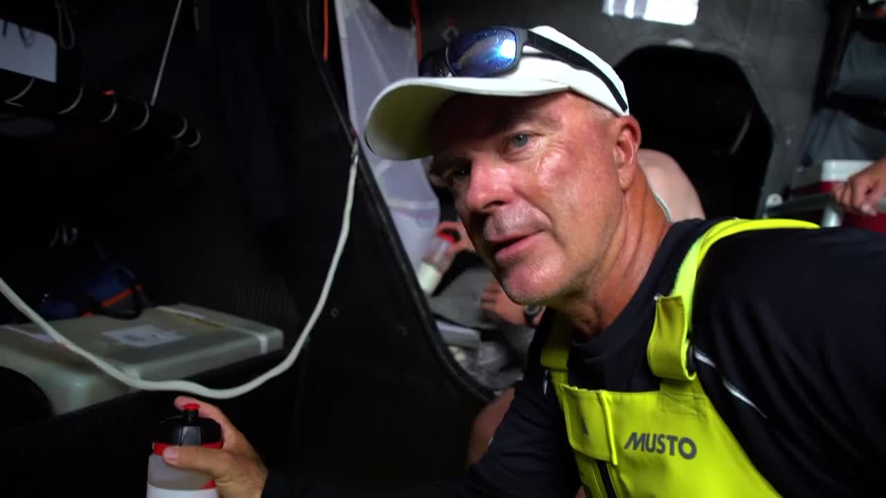 Below, Bouwe talks about competition, winds, minimal doldrum crossing, possibility of a restart in the last 100 miles into Capetown due to the high pressure there. Shots of wheel, compass, Annie talking on rail, horizon.