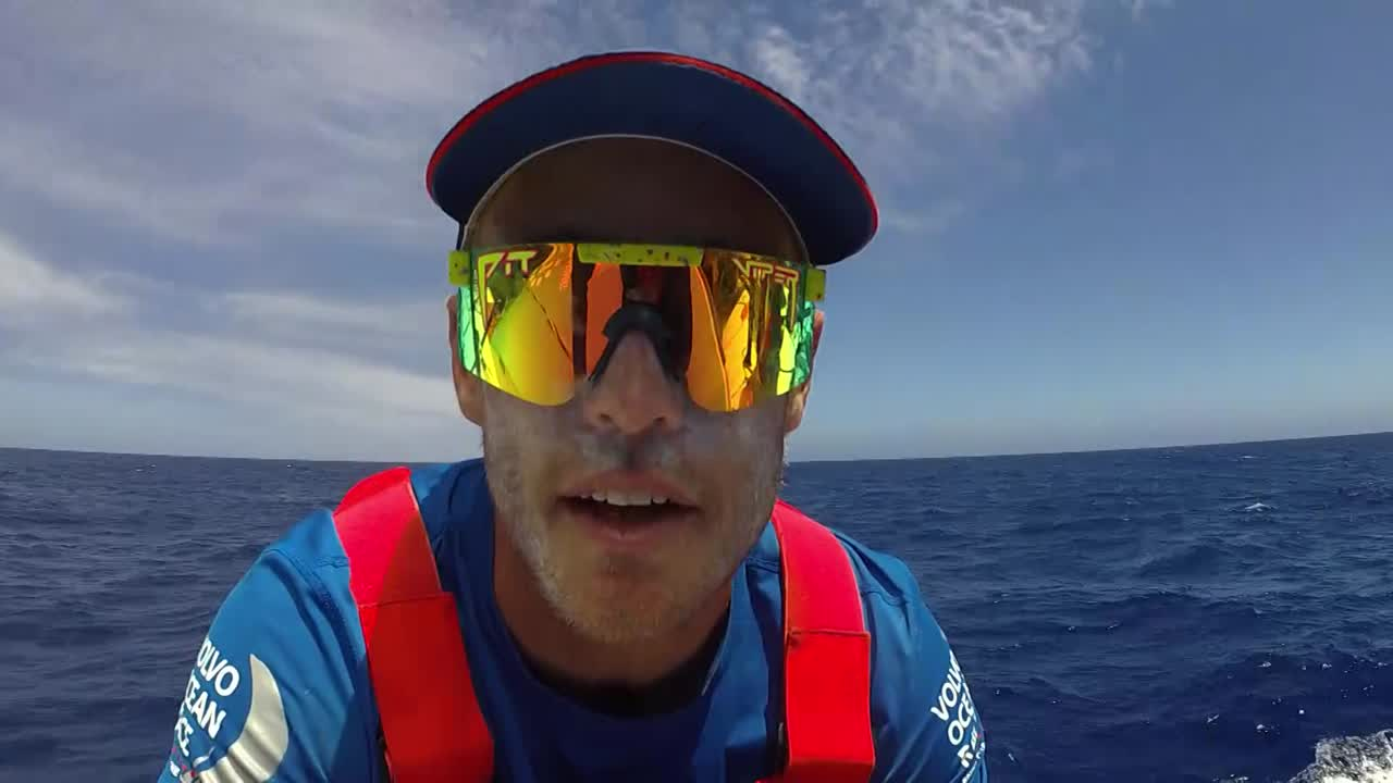 Nick, in mirror-shades, talks about looking at the rig to make sure it looks good. Gopro footage of him going aloft and inspecting the rig. Back on deck he debriefs: everything looks good. Less salty.