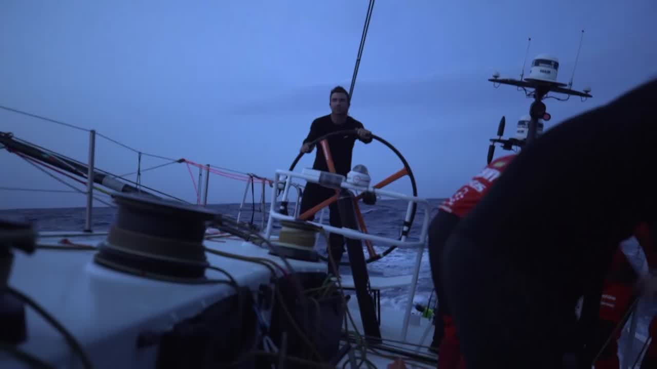 On-board footage as Vestas gybes from starboard to port after sunset. Looks like the gybe that happened around 2017.11.18 21:13:48 UTC. SiFi talks about how they're now heading back east, and trying to pick up a cold front. Timing of the gybe is quite critical. Saw Brunel on the AIS, which encouraged them to gybe when they did. Nick with a headlamp checks the outrigger. Below, closeup shot of the AIS showing them after their gybe.