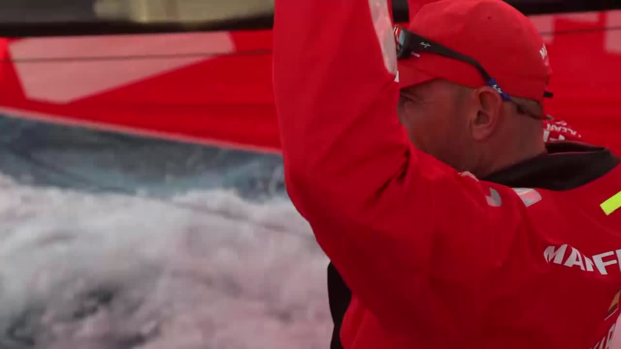 "Blair grinds the middle pedestal. Sophie on the mainsheet: ""Hold."" Xabi talks to her; they both grind. Xabi, to Jen: ""It's all going pretty well."" Talks about other boats around them: Dongfeng, Vestas, AkzoNobel, Brunel. ""Tricky wind; up and down and very shifty."" Gybing early morning. Pablo talks in the cockpit about the routing. ""Maybe we do... 50 knots?"" Sophie: ""Fifty? Oh.. my... god.."" Xabi on the helm: ""We won't do 50."" Pablo: ""Right now the routing says that."" Sophie: ""And that's... 20 knots?"" Xabi: ""Yeah."" Xabi, to Jen: ""It's looking like real windy, next days... In a couple of days, 40 plus for a couple of hours."" Talks about the ice gate. So get rest and food now, for later. Jen: ""Any advice for me?"" Xabi, smiling: ""For you? It's gooa be good. It's gonna be rough (shrugs) and cold. Good fun."" Sophie and Pablo convo continues, about how long it's going to be: up to 6 days. Sophie, to Jen, talks about making sure she's organized, has the right gear on, try to rest as much as she can tonight. ""Just take it as it comes."" Jen: ""Any advice for me."" Sophie laughs. Blair, from the pedestal: ""Hold on."" Sophie: ""Hold on, Jen. Stay down below if you want to."" Blair: ""Have a nice stay in your bunk. That's what I'd do if I could."" Shot of AkzoNobel on their starboard quarter."