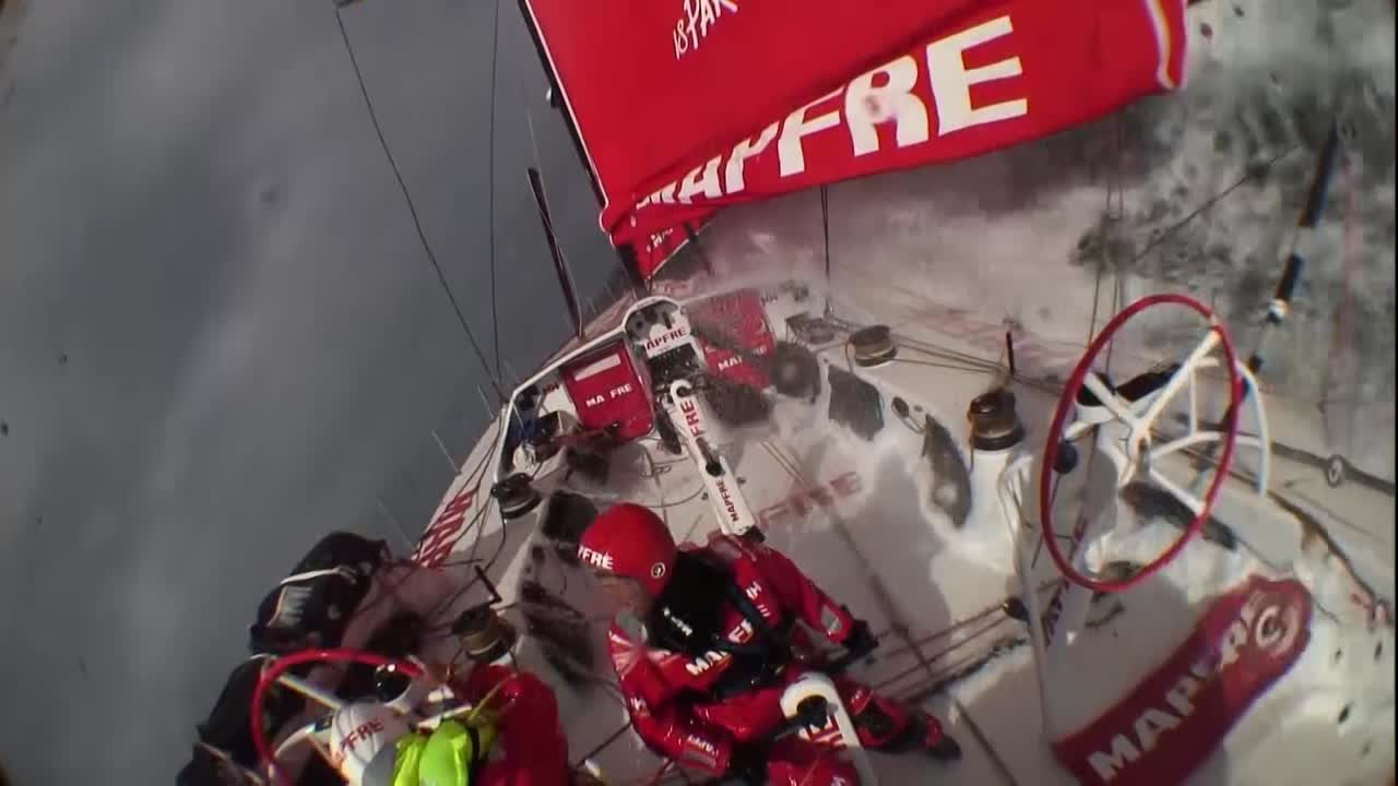 Crash cam footage from the stern cam. Rob is on the helm as MAPFRE surfs in high wind on port gybe. He gets washed off the wheel (and his life vest appears to be inflated already? it certainly is afterward). They broach; Louis runs forward to ease the jib. I think I hear Sophie's voice at one point, too? But I don't see her. Presumably she's trimming the main sheet, behind the helm.