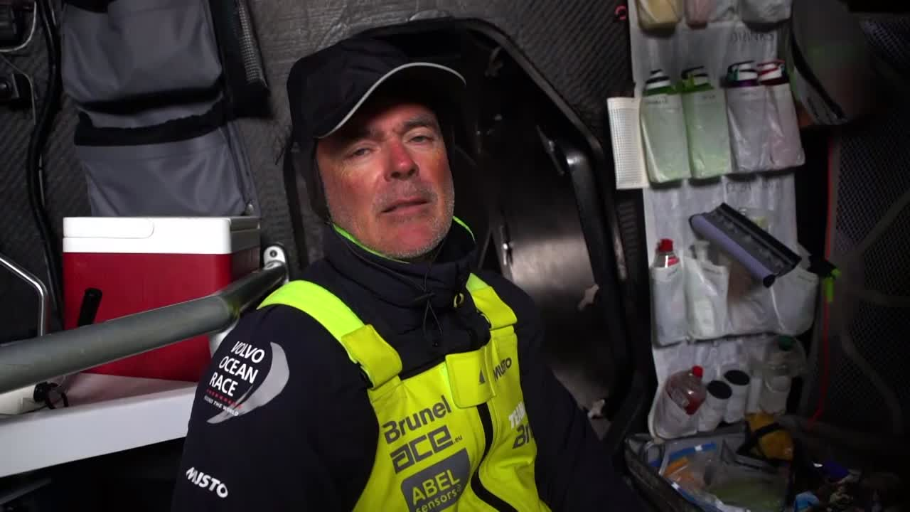 "Bouwe, below, talks about how Dongfeng and MAPFRE are ahead of the low and have a better wind angle than Brunel does. Talks about where the boats are. How they were sailing yesterday in a top speed of 60 knots. ""People have to remember that's Force 12. That's pretty scary. But everything is fine; the boat is in one piece. That's the most important thing. The people are fine as well."" Talks about the outlook, that the people in front get to ride the front longer than them. But you never know; there's 4,000 miles to go. Coming into Melbourne can be tricky. ""We got a mail from the Race Office that they had some breakages. Of course it's unfortunate for them.. just one of those things, a mistake.. of course it's expensive in multiple ways, result-wise probably not very good, and probably get a penalty as well, so it's a double whammy."" Slomo shots on deck: waves, someone steering, grinding, washing machine in sun and high wind. Wake with birds. Someone on the bow with a new sail."