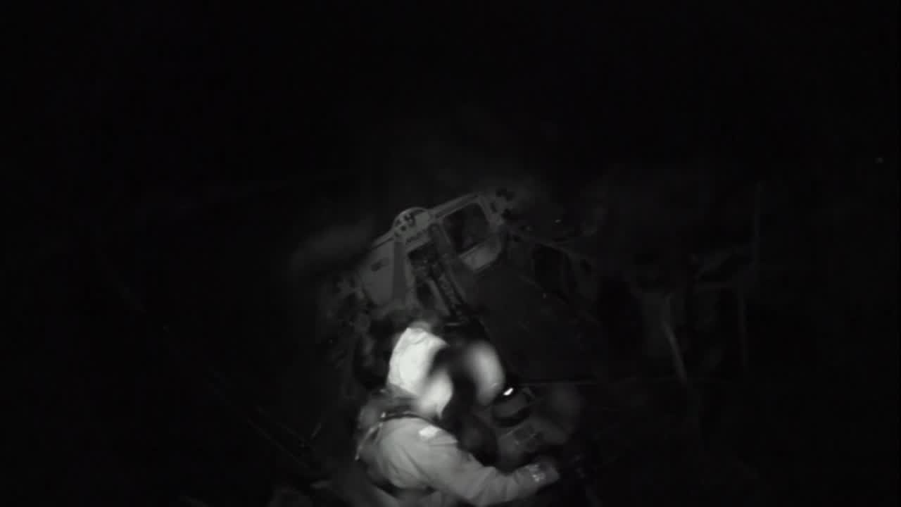 "Night time crash cam/stern cam. Brunel is on starboard with lots of spray. It looks like they broach; person [Carlo, it turns out] moves forward from the aft pedestal to free the headsail sheet. Easing headsail; sails flapping. More crew move forward. Grinding the headsail back in. Below, Peter watches the crash cam video on a tablet. Peter: ""That's us broaching now."" Carlo looks at the video, laughs. Peter: ""Yeah. I was, uh, driving last night and probably pushing a little too hard into a squall. Wiped out at about 30, high 20s, quite lucky, because it got up to about 40 later once we got it under control... Generally it happens when the bow gets stuck in a wave at the wrong time, and you can't bear away. Lose the rudders... Done it a fair few times now, so everyone knows pretty well what to do. Not too dangerous for anyone; just a bit risky for the FR0... Have to push the boat hard. Everyone else is pushing the boat hard... Definitely prefer to go that way than the other way."" Carlo: ""I'm the guy on the aft pedestal, grinding for the main. We start to broach, so I go forward to the pirmary where the FR0 sheet's connected to. I dump 3 or 4 meters of sheet... It's pretty difficult, you can tell by the video that it's not that easy, there's water in your eyes, water everywhere, your orientation is a bit messed up. At the same time you don't wnat to wash off the boat as well, because at the time I wasn't that secure. [Rewatching, I think he was not, in fact, clipped in.] With the heel of the boat as well, it's quite a challenge to actually get there and do the work. But it's nice to see that. I'm actually pretty happy with it... We came out of that pretty well."""