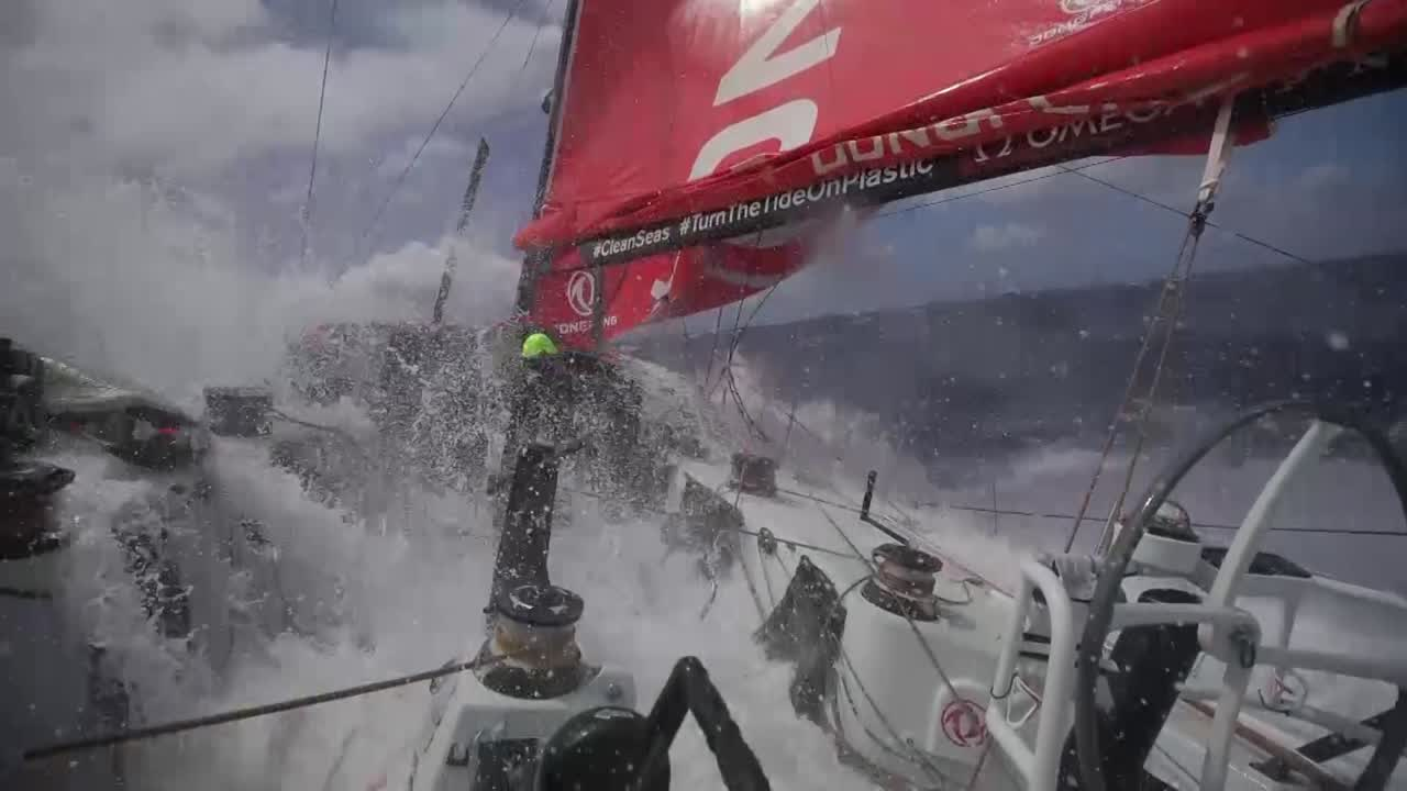 "Wake shot with Dongfeng sailing fast. View forward from stern, double-headed as they sail on port gybe. Washing machine. Below, Jack eats something. He looks a bit shell-shocked. Jack: ""It's been a very brutal leg so far. It's very demanding conditions; always fast, always wet... I don't think I've gone on deck without the wet weather gear the whole race. Everything's wet. Inside the boat's horrible. There's water everywhere. There's water in your sleeping bag, there's water in your personal bag. There's water everywhere. It's been a really hard leg to sleep; every time you seem to get in your bunk there's a gybe or a sail change... It's been a hard leg. Everyone's feeling the push at the moment, everyone's tired... We're close to the end, conditions are still hard at the moment, but everyone's focused on getting to Australia in one piece and in the best place we can... First time I've sailed into Australia, so it's kind of a treat. A big Southern Ocean leg done, which was an unknown for me."" Talks about how a lot of his family witll be in Melbourne for the finish. Hasn't seen some of them in 6 years, so it will be great to catch up with them. Really looking forward to getting in. Shots of water condensing on things in the cabin, water flowing. Marie asleep. Jack putting Sudocrem on his hands, face. ""It might look ridiculous."" But explains how the cream helps with little cuts and sores from the gaskets and salt water. Black, below, talks about how it's a long day, and a lot of pressure, lack of sleep. ""A bit tired, yes."" Shots of the cockpit from the cabin, washing machine."