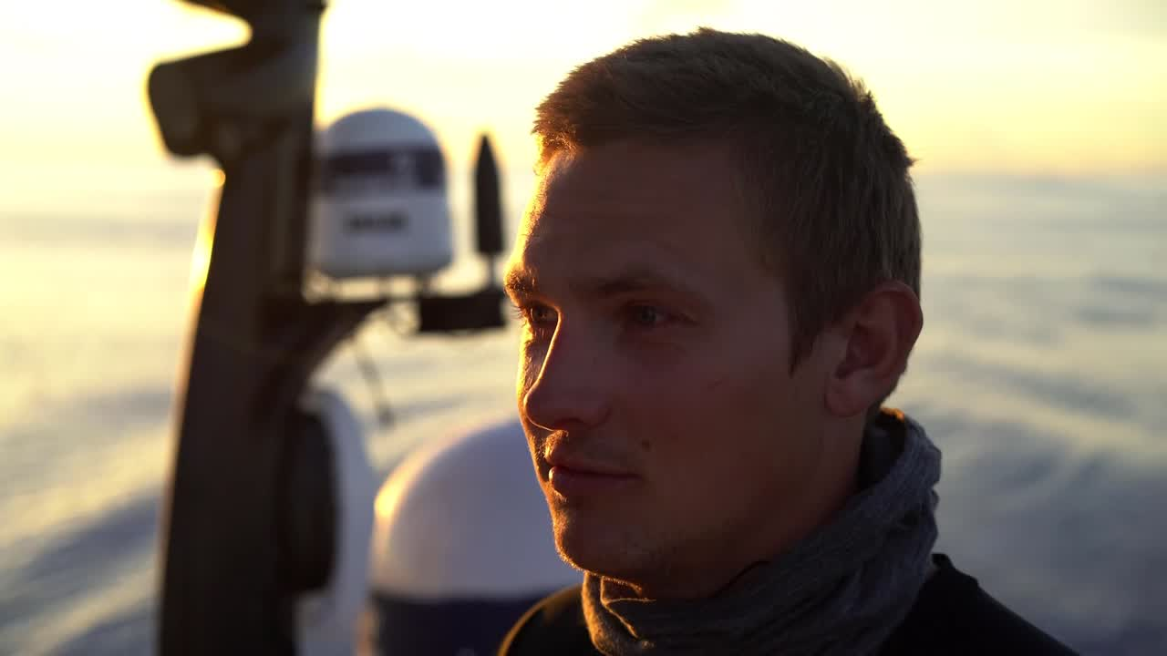 """Kyle, on the helm in glassy conditions at sunrise, talks about how slow it's been. They've been going 1 knot; """"with 3 and a half knots now it feels like 20."""" Jens trims, chuckles. """"Hot. Hot and slow."""" Yann's longer-lens closeups are cool-looking. Sally: """"Torture."""" Abby sleeps in her bunk. Closeup of a fan. Sam, at the galley sink: """"Frustrating. Extremely frustrating and slow."""" Awesome drone shots of Brunel sailing upwind with a giant, dark rain cloud behind them. They peel from J1 (I think) to the MH0 while the drone videos them. Abby looks through binoculars at their competitors. """"I see a boat with red sails, so could be Dongfeng or could be MAPFRE."""" Jens: """"They're still ahead of us, but catching up just now. Got some good breeze now."""" Then a shot of them slatting in no wind again. Fish breaking the surface. Sunset. Favoriting this one just for that drone sequence."""