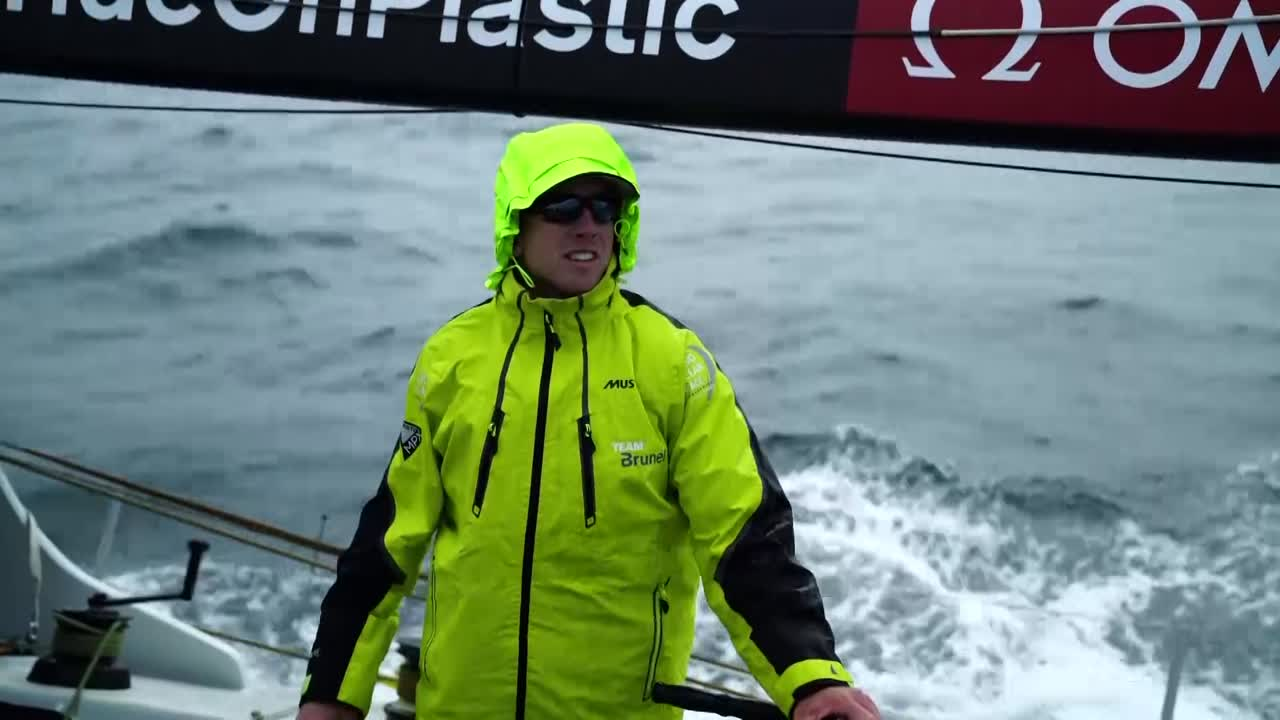 "Peter talks about their mode: ""Generally have more heel than anyone else."" Below, he talks about Dongfeng gaining recently. Talks about ballast tanks, different set ups. Have made a gain compared to earlier on. Shot of Dongfeng a few boatlengths ahead of them. Bouwe below, talks about having good speed, and suddenly getting slow. Had a big plastic bag on the rudder. Did two tacks to clear it. Lost some distance, but are making gains again. Peter clears the rudder. Dongfeng ahead of them and to weather. Bouwe at the nav station talks about the feeling in the China stopover being good. Talks about Peter being competitive (as they all are). ""But it feels good on board."" Night shot of AkzoNobel and Dongfeng to leeward as night falls; a boat astern of them with green masthead running light showing. Side note: I love Yann's use of longer lenses. Gives it a really different, more cinematic/epic feeling."