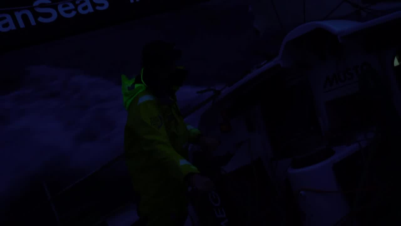 """Night shots of them sailing on starboard. Another boat in the background. Kyle talks about how all night they've been within a mile or so of the other two boats, pushing hard. Cool night/dim shots. Dongfeng. Kyle: """"Nice to be fighting with the leaders."""" Gives them confidence. Kyle cleans up lines in the pit. Stands on the outrigger to adjust the J1 leech cord. Cool drone shot in dim light of Brunel going to weather with Dongfeng in the background, a quarter mile away. Kyle on the foredeck. Another sweet drone shot, circling them to show both Dongfeng to leeward and AkzoNobel ahead and to weather. Kyle goes below with his toothbrush. Bouwe sits at the nav station, looking at a chart. Kyle gets in his bunk."""