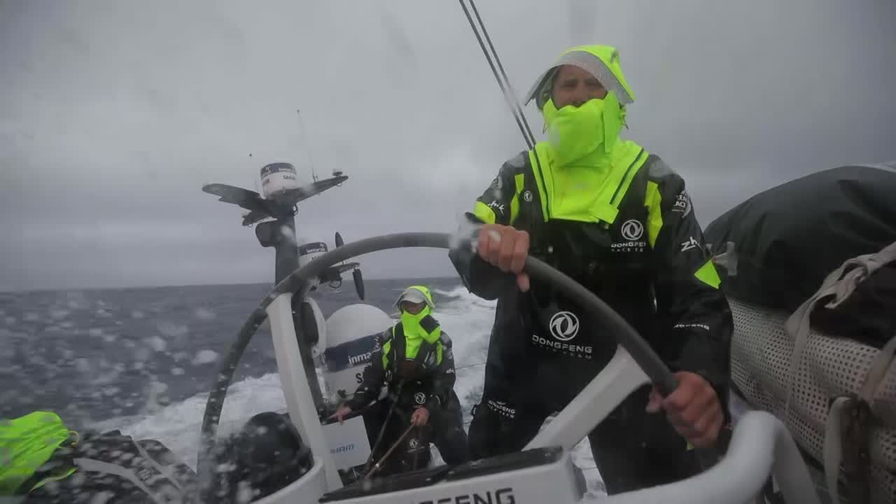 Charles driving fast on port gybe; firehose in his face. Washing machine with what loooks like J2 and a reefed main. Kevin, below, talks about going through a front. Is why they've been going northeast. To catch this pressure. If you're not overpowered you need to put up more sail. Slomo washing machine in the cockpit.