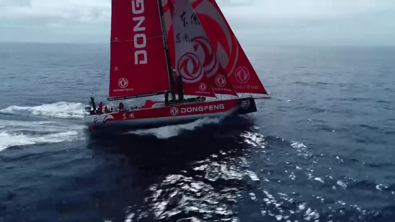 Drone shot overtaking Dongfeng, sailing pretty fast, triple-heading with the MH0 on starboard. More drone shots. MAPFRE visible several miles away on their starboard quarter.