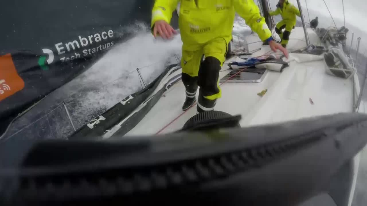 GoPro (Garmin) shot as Yann films on the foredeck. He goes forward and puts the Peter Gabriel cam on Carlo, who's hanking on the J1. Carlo grins.
