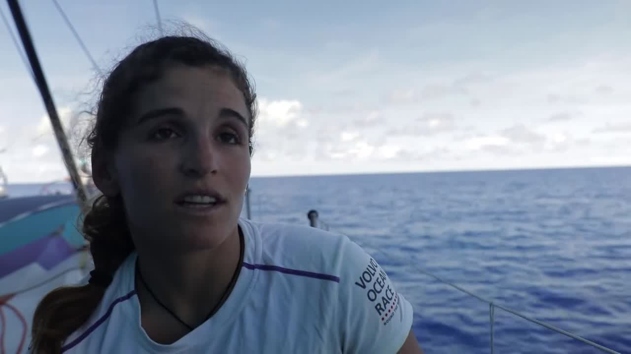 Martine, on deck, talks in Portuguese about the doldrums, the heat. Simeon, sitting on the lowered J1 on the bow, talks in Dutch about the islands they're passing as the MH0 flops behind him.