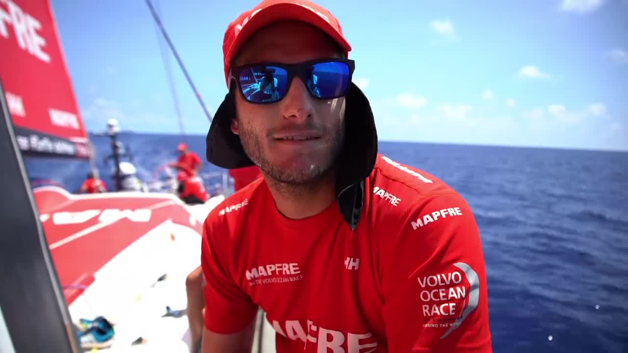 Everyone answers the question: What is MAPFRE's secret weapon? Tamara: Answers in Spanish. Willy: Answer's in Spanish. Louis: Xabi. Xabi is the secret weapon. Blair: Willy. Willy: (With Dongfeng behind him as he trims): Answers in Spanish. Pablo: Answers in Spanish. Rob: Our optimism. We're all very hopeful. Tamara: Talks in Spanish. Rob: Coffee, and looking forward to your next sleep. Willy: In Spanish. Xabi: In Spanish. Pablo: In Spanish. Xabi: In Spanish. Sophie: Talks about how the fact that you're racing keeps you going despite the fatigue. Joan: Talks in Spanish. Blair: Staying positive; trying to keep the boat going as fast as you can.