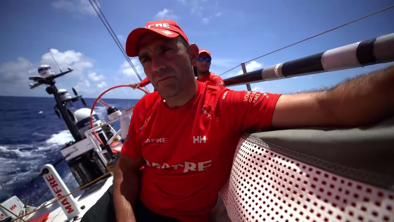 Xabi talks about how the weather has been changing, and there's a big split in the fleet. Louis: Dongfeng about 8 miles behind. Hopefully get a chance to catch Brunel in the next few days. Wind changes so quickly in the New Zealand that the forecast is changing every 4 hours. Anything can happen. Shadow on the sail as Louis takes the tack of a sail forward. Willy and Tamara grinding as Louis works the foredeck on a sail change. Sophie grinding. Xabi trimming.