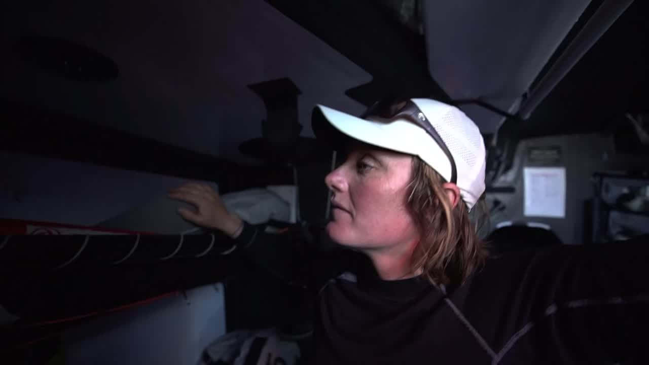 Marie, below, says it's time to wake up Carolijn and Jeremie. He does so, quietly, with a grab on the leg. Black talks about sleeping. He wakes up Jack by shaking his foot. On deck, MAPFRE is a mile away. Daryl, on the helm, does a trick with his hat. Grinding. Sail changes. Jack wrestling a sail on the foredeck. Kevin and Jeremie in the pit. Stacking. Kevin on the helm; MAPFRE abeam to leeward. Daryl, below, talks about New Zealand's long and proud history of the Volvo. He watched it growing up; now sailing in his fourth one. Pretty amazing. What he loves doing. Being able to have a job doing what you love is the most important thing.