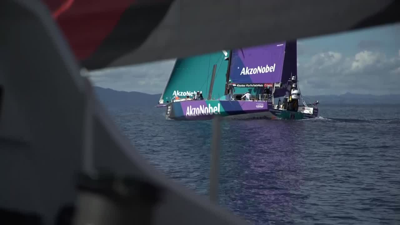 "Antonio looks through binoculars at AkzoNobel, sailing in light air a quarter-mile ahead of them. AkzoNobel a quarter-mile to leeward. Witty calls for crew to get out of the forepeak and right on the bow. At the nav station: Witty says ""238 miles of this rubbish... Wait for the right opportunity. Patience..."" Sailing alongsisde Akzo. Alex trimming. Witty: ""Just press in the puff."" Trystan: ""Full on, isn't it? We'll keep changing watch; keep the fresh people going... They just got nudged ahead."" Libby, looking at her tablet, calls the angle on the other tack. Tacking the MH0; AkzoNobel three-quarters of a mile ahead of them. Antonio: Tight to the end. Libby looking through binoculars: ""Pretty patchy out where Dee is."" Libby explains that they got too focused on Akzo, maybe, and didn't pay enough attention to TTToP. Marcus discusses whether they'll be able to stay ahead of TTToP. 100 miles to go. ""Not having a meltdown just yet."" Shot of TTToP on the horizon."