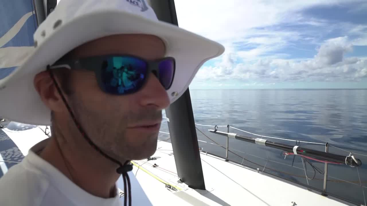 Shot of MAPFRE and Dongfeng closing. Nicolas talks about how far behind they were a day ago; now they have 8 knots of wind while TTToP is drifting. Bernardo talks about going asleep with them out of sight, and on top of the leaders, but then waking up and having the two trailing boats on their hip. They're fighting with each other; hopefully we can sail away and go for third place. Francesa takes a line off the clew of the MH0 while Bianca holds onto her. Dee talks about how it's a lot tighter than they expected. They tracked the boats in front down and got much closer, but then they got the breeze, and meanwhile the boats bdhind caught them. She'll be absolutely gutted if they don't get the result they deserve. Liz looking intense on the helm. Henry: We've been racing for three weeks, and we have a 100-mile race beween 5 boats. It's gonna be a big next 10 hours, and hopefully we can hold on and get on the podium... Two fastest boats in the fleet bearing down on us. Going to be an intense few hours.