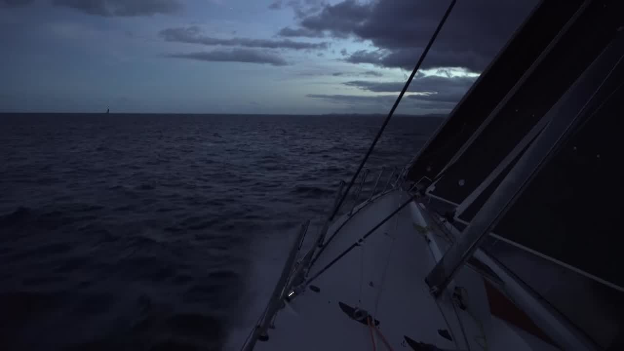 "Antonio: Finally, with the sunset the wind is here. Last 70 miles will be fast. A bit afraid because Dongfeng and MAPFRE are catching up very fast. They're now 6 miles behind. Stacking aft below. Crew in the moonlight. Lights on shore. Marcus: If we can keep this up, a few more hours of downwind sailing. Maybe slide past the guys in front. Got a jump on the guys behind us. Still gunning for that top spot at the moment. Witty on the helm in the moonlight. Near broach. ""Ease, ease, ease! Mainsheet! Mainsheet!"" Sailing fast. Fish recaps: Cloud line came through earlier; Akzo got it first and extended a little. They've managed to hold off TTToP, MAPFRE, and Dongfeng. Just trying to challenge Akzo for the win. Libby at the nav station. ""It's all action here. 30 miles to the finish. It's all on in the last miles."""